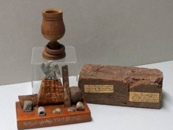 An Assemblage of relics from Gettysburg, 1863; a goblet made of wood from the famous peach orchard, 1896; and a brick from Appomattox, 1865