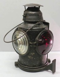 Signal Lantern, 1915-1925. This kerosene lantern was used by the Hershey Transit Company. It affixed to a trolley and was used to mark whether the streetcar was going, slowing down, or stopping.