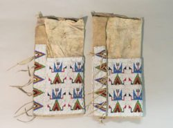 Leggings, 1900-1925, Sioux. Glass seed beads adorn these leggings, with tepee designs along sides.