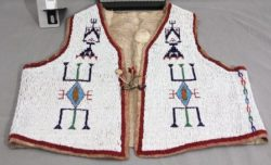 Vest, 1875-1900, Sioux. Heavily beaded with seed beads, vests like this became popular during the mid-1800s and early 1900s.