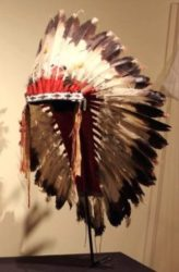 Headdress, 1880-1920, Sioux. Adorned with feathers, glass beads, hair, and metal.
